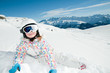 Happy skier playing in snow - space for text