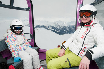 Ski vacation - skiers in cable car