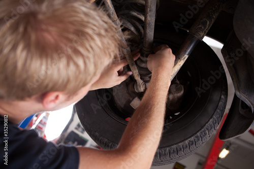 Mechanic Inspecting CV Joint