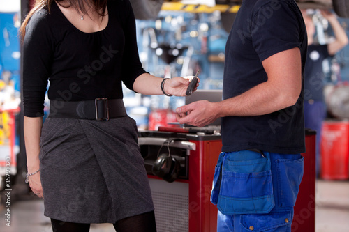 Customer in mechanic Shop Delivering Key