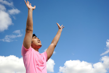 Cheerful young man against blue sky
