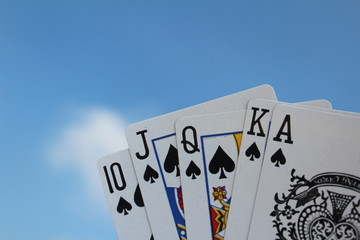 Poker hand - Royal Flush, with sky background