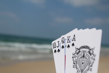 Poker hand - Royal Flush, with beach background