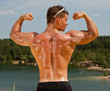 Muscle sexy wet young man back and biceps