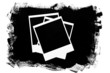 Photo frames over grunge black background