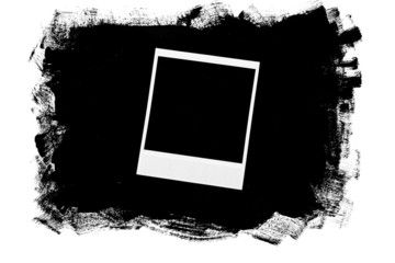 Photo frame over grunge black background