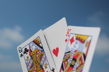 Playing cards - the king loves the queen, with sky background