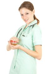 young female doctor in blue workwear keeping urine to analysis