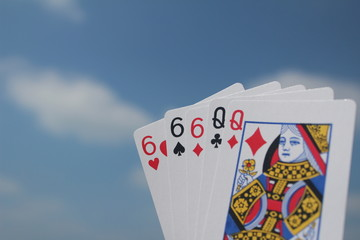 Poker hand - Full House, with sky background