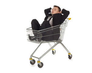 businessman in black suit in shopping cart