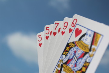 Poker hand - Flush, with sky background