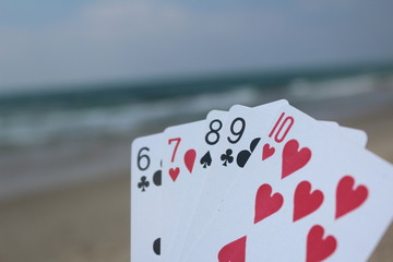 Poker cards with a beach background - Straight Flush hand