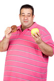 Fat man deciding between a candy and an apple poster