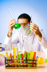 Chemist in the lab experimenting with solutions