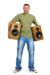 Young man with two speakers isolated