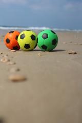 Three colorful balls at the beach