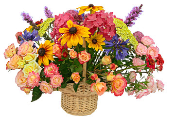 Flower arrangement in a basket isolated on a white background