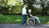 Disabled woman in wheelchair in park