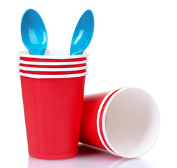 red plastic cups and blue spoons isolated on white