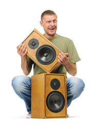 Man with two wooden speaker on white background
