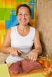 woman cutting beef