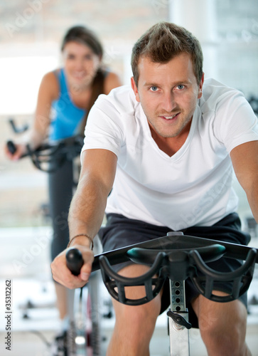 People doing spinning at the gym