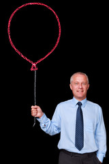 Businessman holding a chalk balloon
