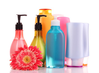 bottles of health and beauty products on white background