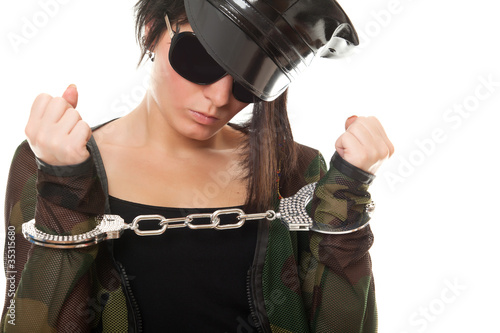 young woman police officer with handcuffs