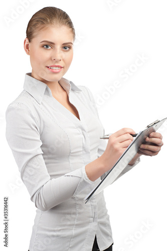 Business woman writing on clipboard
