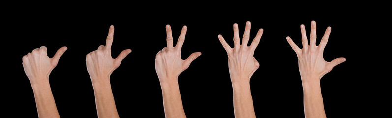 Hands making numbers, black background.