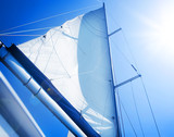 Sails over blue Sky. Yachting concept. Sailboat