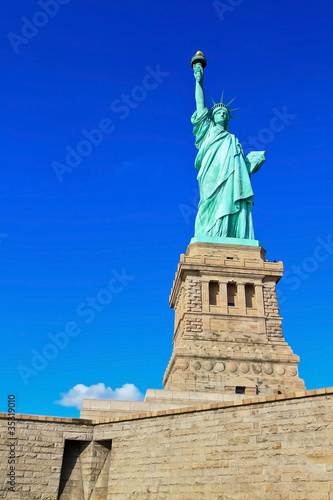 Statue of Liberty on foundation with blue sky