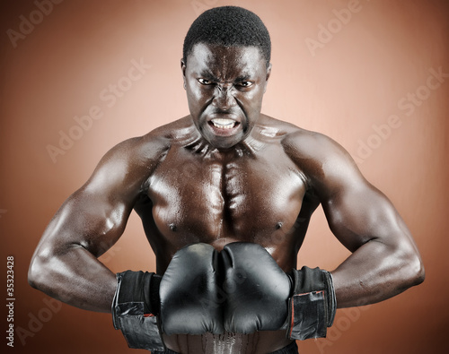 Muscular boxer with intense emotion