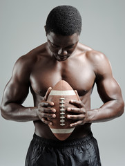 Muscular american football player