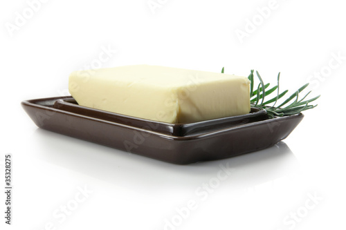 fresh butter with rosemary decoration in butter dish