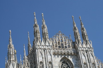 the steeples of the church façade of the Duomo of Milan