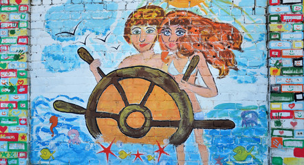 girl and boy at the helm. Graffiti