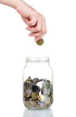 Glass bank for tips with money and hand isolated on white. Ukrai