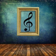 Interno grunge, cornice dorata, chiave di violino