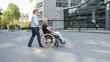 Woman in city with wheelchair