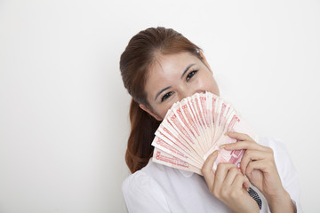 Happy woman hiding behind money