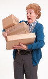Alarmed senior woman with packages
