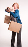 Senior woman with falling parcels