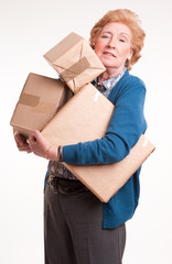 Senior woman carrying lots of heavy parcels
