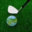 golf club and globe on a background a green grass
