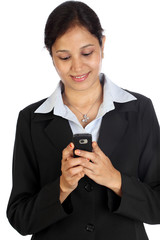 Young businesswoman text Messaging