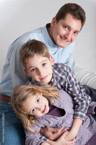 .Portrait of a man and his two children, boy and girl.