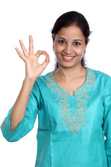 Young beautiful woman making OK sign