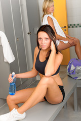Locker room young sportive woman outfit sitting